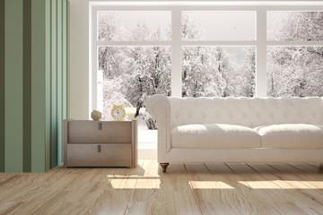 White room with sofa and winter landscape in window. Scandinavian interior design