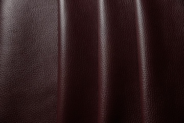 Red leather texture background close up macro