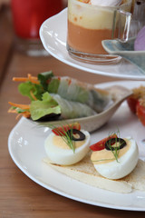 Boiled eggs on white plate.