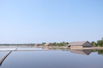 Sea salt farm and blue sky in thailand.