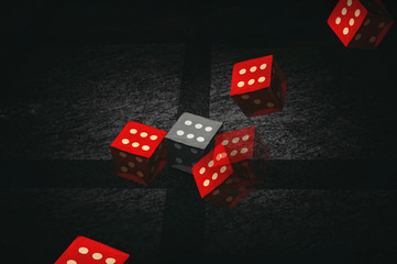 Red and grey dice on a marble background