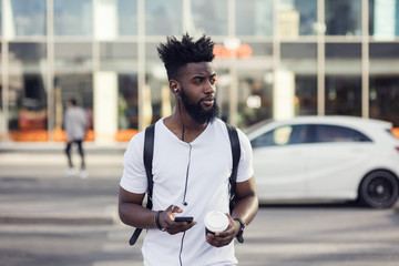 Young man using smartphone in street