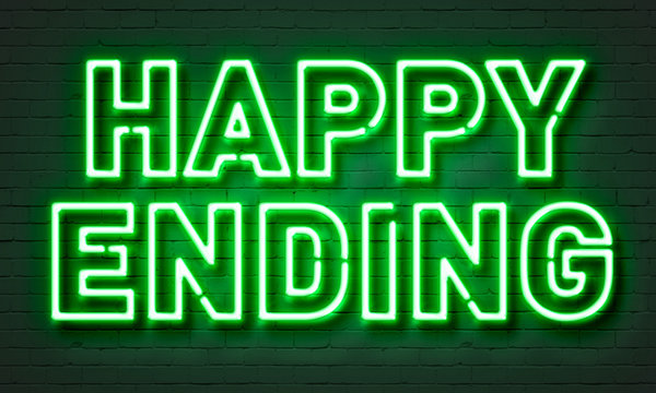 Happy ending neon sign on brick wall background.