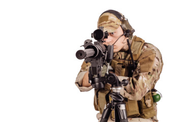 Portrait soldier or private military contractor holding sniper rifle.