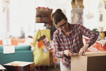 Owner unpacking box at store