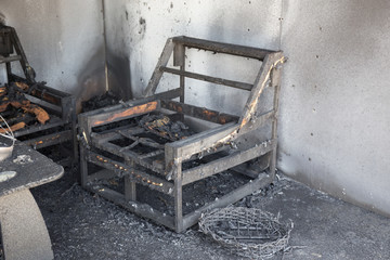 chair and furniture in room after burned by fire in burn scene