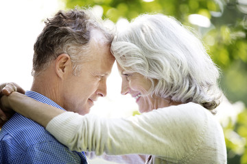 Mature couple with foreheads together