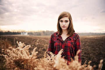 Portrait of young woman on farm