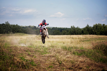 Motocross rider performing stuns