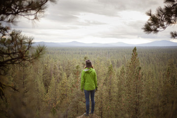 Young woman looking at forest