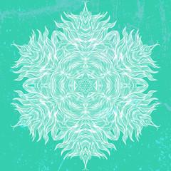 Mandala design in white on aqua green