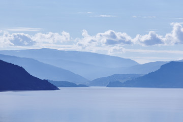 Norwegian fjord landscape in blue tone. Tourism Norway. Travel