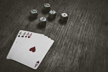 four aces playing cards and dice with copyspace