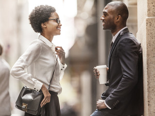 Man and woman talking on street
