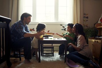 Family with two children (18-23 months) spending time together at home