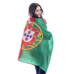 Young woman holding a large flag of Portugal