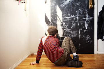 Boy chalk drawing at home