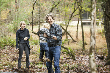 Family with son (18-23 months) standing in forest