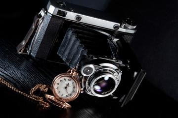 Retro camera and pocket watch
