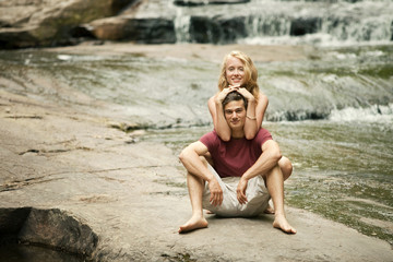 Portrait of couple on riverbed