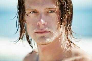 Portrait of surfer in sunlight
