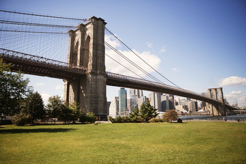 Brooklyn Bridge over east river with city in background