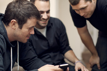 Friends hanging out looking at cell phone