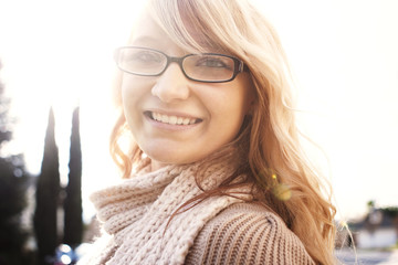 Portrait of young woman smiling outdoors