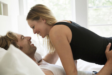 View of mid adult couple in bed