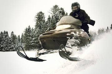 Man riding snowmobile