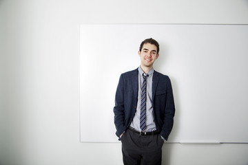 Young business standing in front of whiteboard