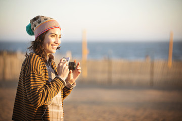 Young woman photographing at seaside