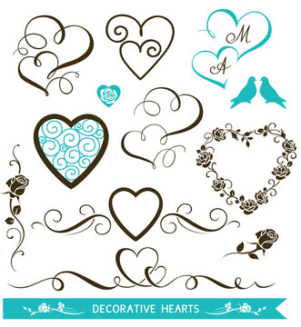 Set of decorative calligraphic hearts for wedding design. Valentine's Day hearts and floral love elements. Vector illustration