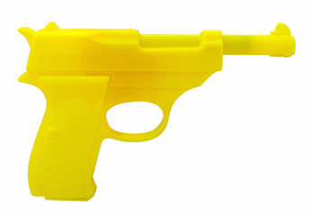 Plastic yellow pistol-luger. Isolated.