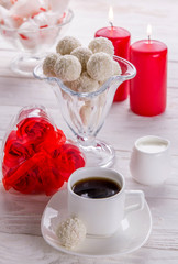 White coconut candies with cup of coffee