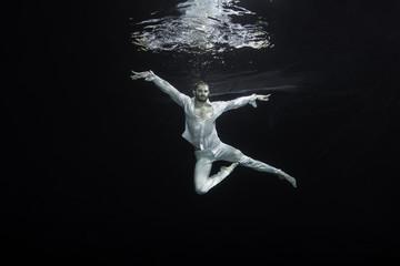 young male ballet dancer unerwater