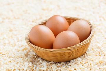 Chicken eggs on sawdust