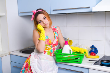 The girl cleans the kitchen