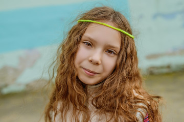 Little beautiful smiling girl with long hair