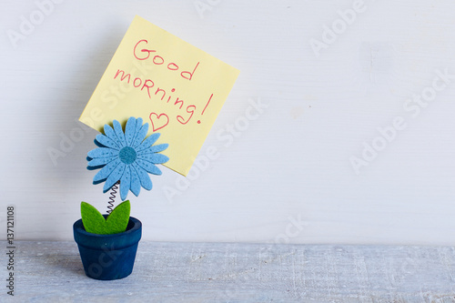 """Good morning note message on a blue pot felt textile"