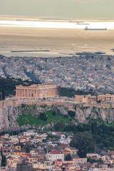 Parthenon temple on the Acropolis against sea in Athens, Greece