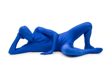 Mysterious blue man in morphsuit lying on the floor