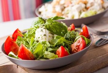 Italian salad with fresh mozzarella cheese, lettuce, tomato and basil