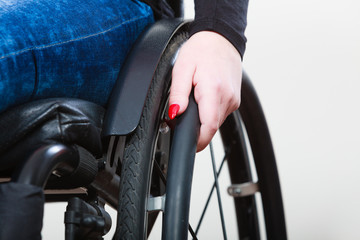 Person sitting on wheelchair.
