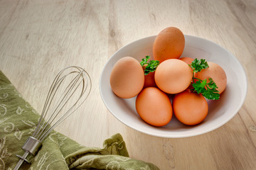 Eggs in a bowl with whisk