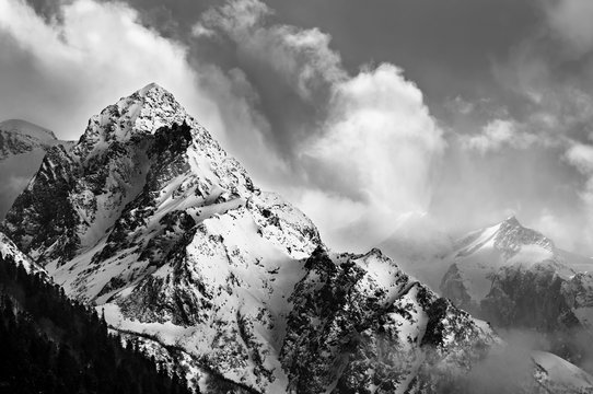 Black and white picture of snowy mountain peak