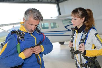Parachutists securing equipment