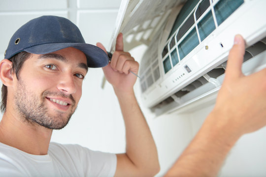 Portrait of air conditioning serviceman