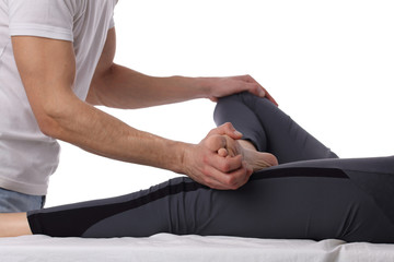 Chiropractic, osteopathy, dorsal manipulation. Therapist doing healing treatment on women's leg . Alternative medicine, pain relief concept isolated on white.