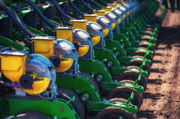 Tractor plowing farm field in preparation for spring planting